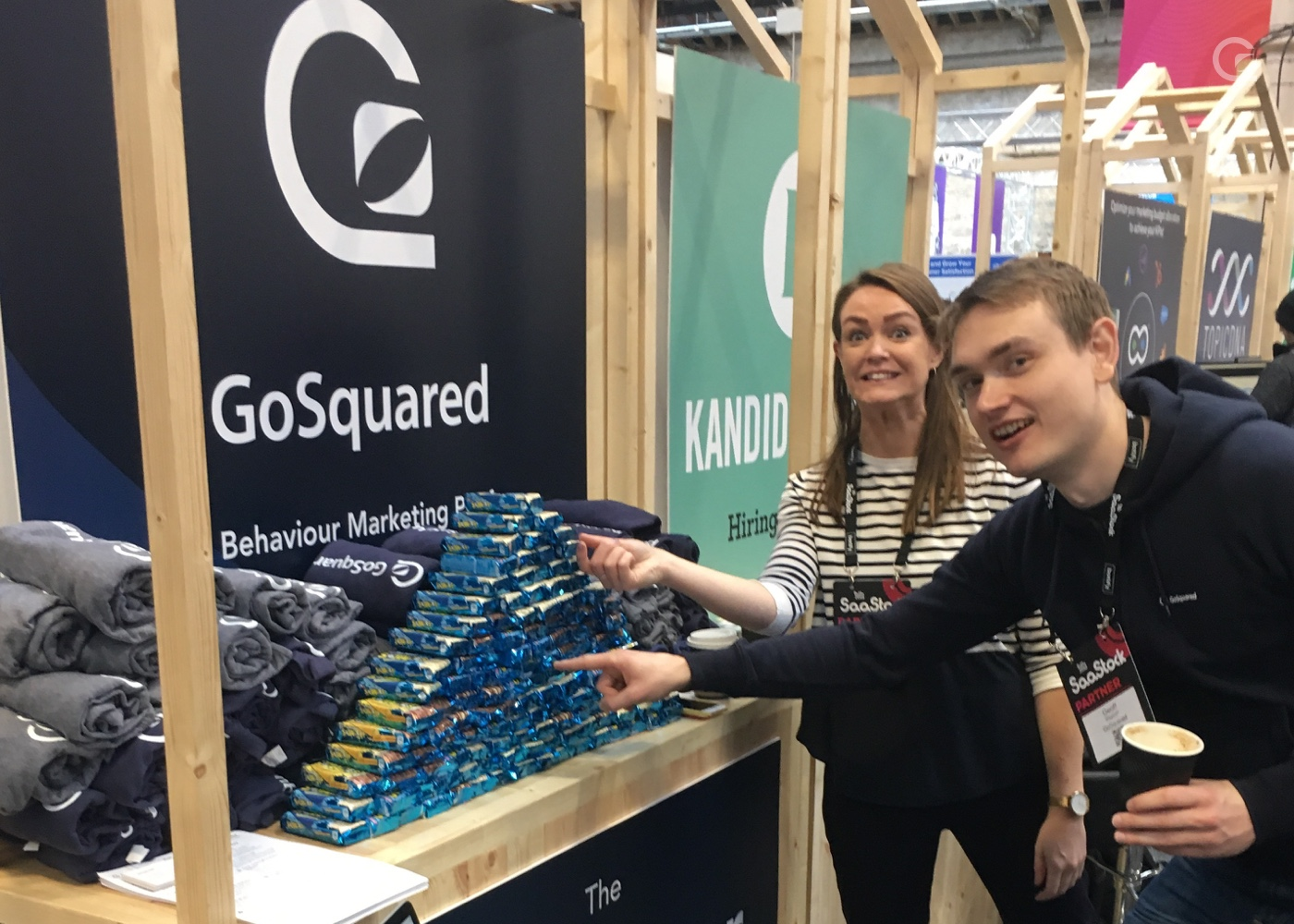 photo of Sinead and Geoff at the GoSquared stand pointing at rice krispy squares